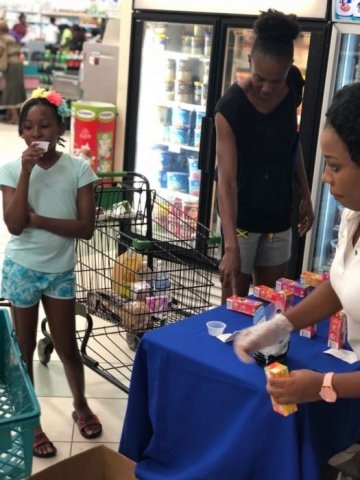 Mother and Daughter Checking out Juice Time at the supermarket