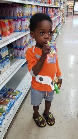 Little boy drinking Hey Kids It's Juice Time Box
