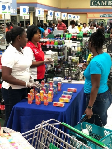 Workers sampling the juice time juice to adult woman